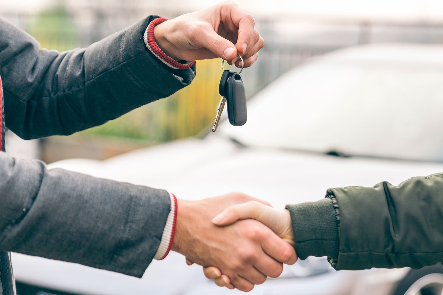 People shaking hands and handing over keys